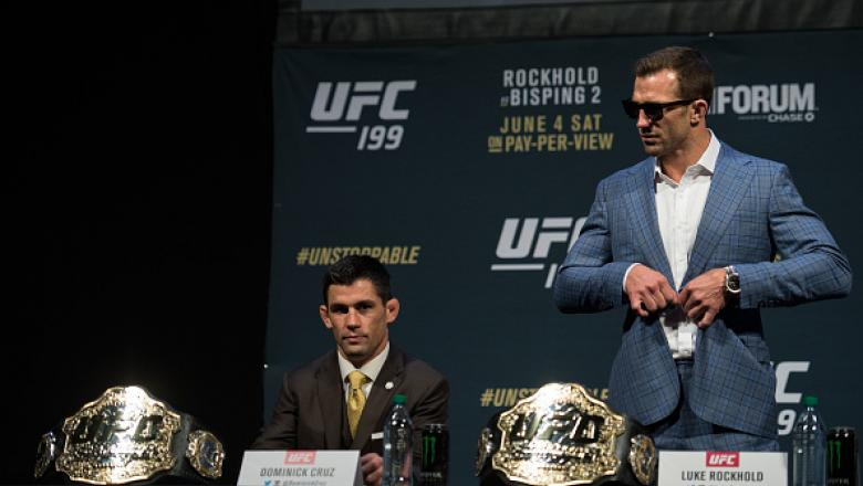 INGLEWOOD, CA - JUNE 02:   (L-R) Bantamweight champion Dominick Cruz and middleweight champion Luke Rockhold prepare to speak to the media during the UFC 199: Press Conference at the Forum on June 2, 2016 in Inglewood, California. (Photo by Brandon Magnus