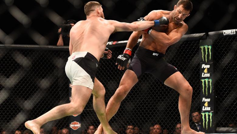 INGLEWOOD, CA - JUNE 04:  Michael Bisping of England throws a right at Luke Rockhold during the UFC 199 event at The Forum on June 4, 2016 in Inglewood, California.  (Photo by Jeff Bottari/Zuffa LLC/Zuffa LLC via Getty Images)
