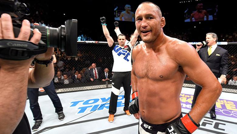 INGLEWOOD, CA - JUNE 04:  Dan Henderson celebrates after his knockout win in the second round against Hector Lombard in their middleweight  bout during the UFC 199 event at The Forum on June 4, 2016 in Inglewood, California.  (Photo by Josh Hedges/Zuffa L