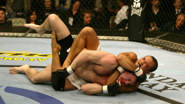 LAS VEGAS, NV - JANUARY 25:  (R-L) B.J. Penn secures a rear choke submission against Matt Hughes during their welterweight championship bout at UFC 46 inside the Mandalay Bay Events Center on January 25, 2004 in Las Vegas, Nevada. (Photo by Josh Hedges/Zu