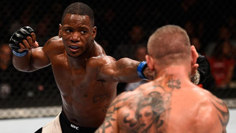 JULY 08: (L-R) Will Brooks punches Ross Pearson of England in their lightweight bout during The Ultimate Fighter Finale event at MGM Grand Garden Arena on July 8, 2016 in Las Vegas, Nevada. (Photo by Jeff Bottari/Zuffa LLC/Zuffa LLC via Getty Images)