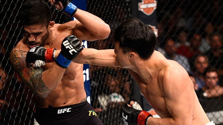 JULY 08: (R-L) Doo Ho Choi of South Korea knocks down Thiago Tavares of Brazil with a punch in their featherweight bout during The Ultimate Fighter Finale event at MGM Grand Garden Arena on July 8, 2016 in Las Vegas, Nevada. (Photo by Jeff Bottari/Zuffa L