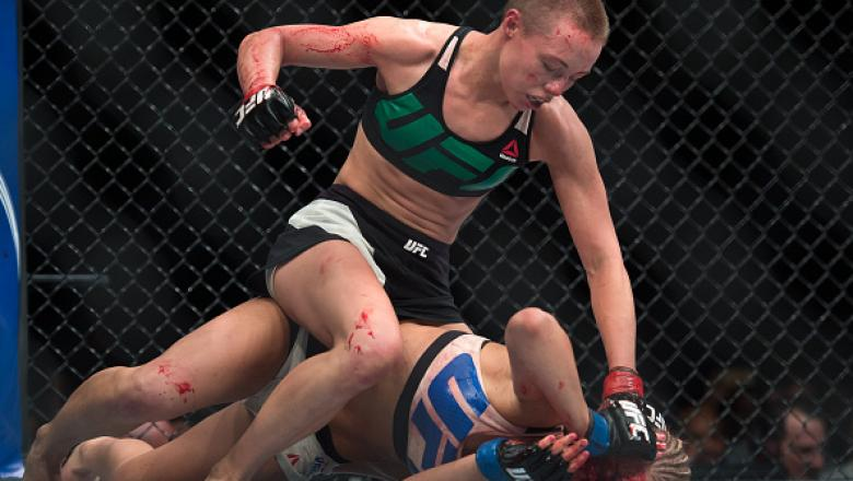 LAS VEGAS, NEVADA - DECEMBER 10:  (Top) Rose Namajunas punches Paige VanZant in their women's strawweight bout during the UFC Fight Night event at The Chelsea at the Cosmopolitan of Las Vegas on December 10, 2015 in Las Vegas, Nevada.  (Photo by Brandon M
