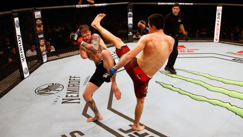 Jesus Pinedo of Peru kicks Devin Powell in their lightweight bout during the UFC Fight Night