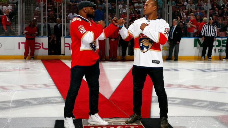 Yoel Romero and Jacare Souza face off during a Florida Panthers game