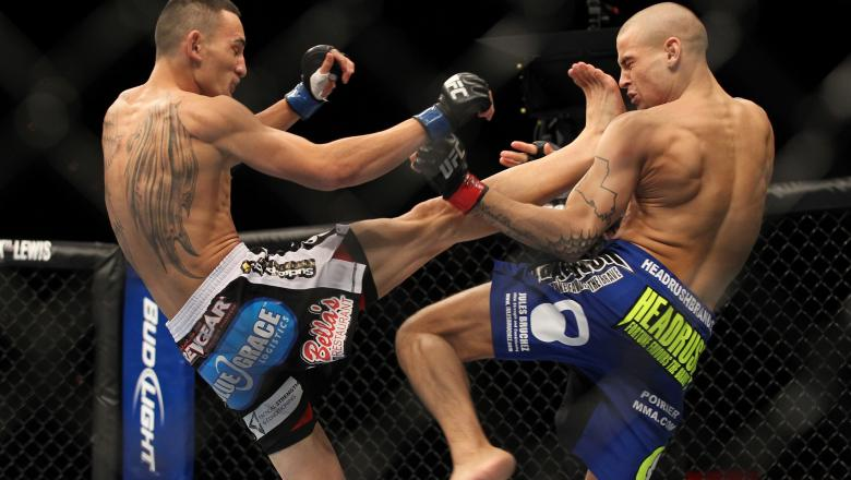 Max Holloway kicks Dustin Poirier during the UFC 143