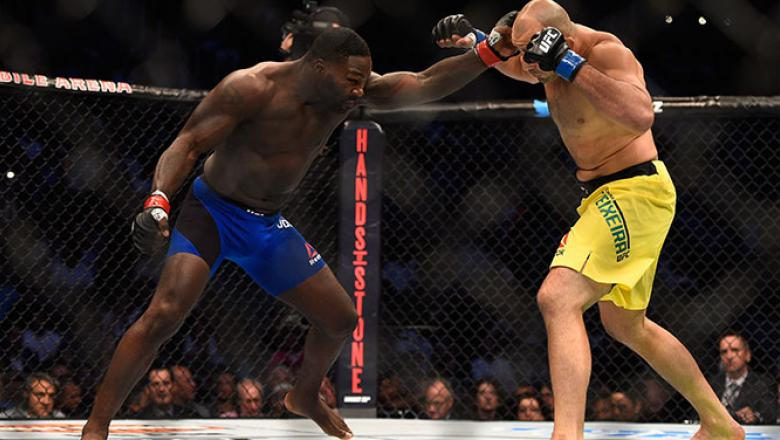 AUGUST 20: Anthony Johnson fights Glover Teixeira of Brazil in their light heavyweight bout during the UFC 202 event at T-Mobile Arena on August 20, 2016 in Las Vegas, Nevada. (Photo by Jeff Bottari/Zuffa LLC/Zuffa LLC via Getty Images)
