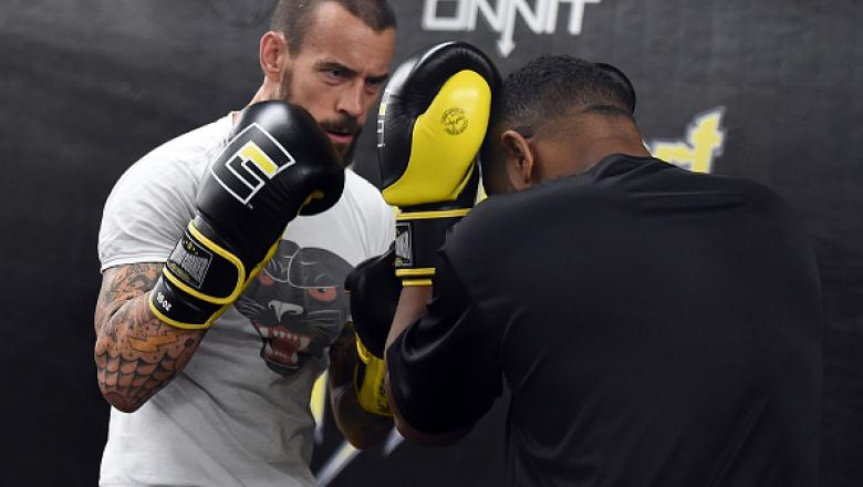 "MILWAUKEE, WI - AUGUST 29:  CM Punk (L) spars with Mike ""Biggie"" Rhodes (R) during a training session at Roufusport Martial Arts Academy on August 29, 2016 in Milwaukee, Wisconsin.  (Photo by Stacy Revere/ Zuffa LLC/Zuffa LLC via Getty Images)"