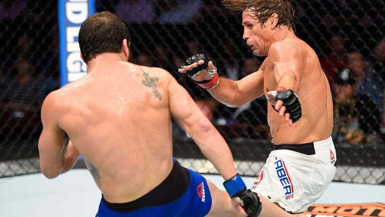 CLEVELAND, OH - SEPTEMBER 10:  (L-R) Jimmie Rivera lands a kick to the leg of Urijah Faber in their bantamweight bout during the UFC 203 event at Quicken Loans Arena on September 10, 2016 in Cleveland, Ohio. (Photo by Josh Hedges/Zuffa LLC/Zuffa LLC via G