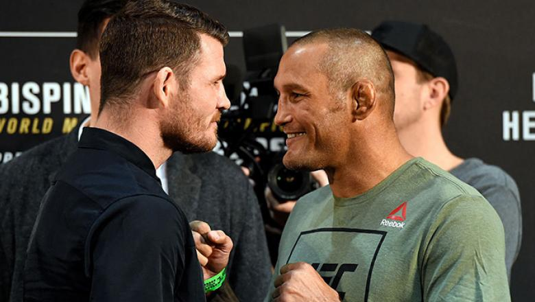 MANCHESTER, ENGLAND - OCTOBER 06:   (L-R) Opponents Michael Bisping of England and Dan Henderson face off during the UFC 204 Ultimate Media Day at Manchester Central on October 6, 2016 in Manchester, England. (Photo by Josh Hedges/Zuffa LLC/Zuffa LLC via