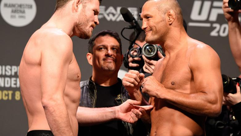 MANCHESTER, ENGLAND - OCTOBER 07:  (L-R) UFC middleweight champion Michael Bisping and Dan Henderson of the United States face-off during the UFC 204 weigh-in at the Manchester Central Convention Complex on October 7, 2016 in Manchester, England. (Photo b