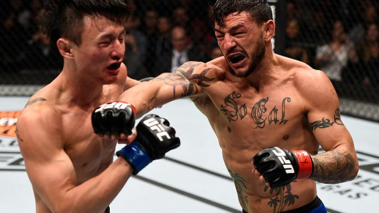 TORONTO, CANADA - DECEMBER 10:  (R-L) Cub Swanson punches Dooho Choi of South Korea in their featherweight bout during the UFC 206 event inside the Air Canada Centre on December 10, 2016 in Toronto, Ontario, Canada. (Photo by Jeff Bottari/Zuffa LLC/Zuffa
