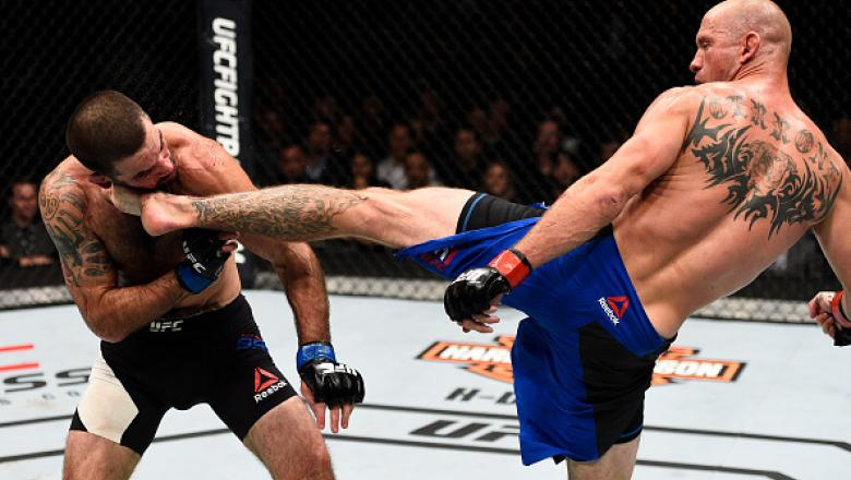 TORONTO, CANADA - DECEMBER 10:  (L-R) Donald Cerrone knocks out Matt Brown with a kick to the head in their welterweight bout during the UFC 206 event inside the Air Canada Centre on December 10, 2016 in Toronto, Ontario, Canada. (Photo by Jeff Bottari/Zu