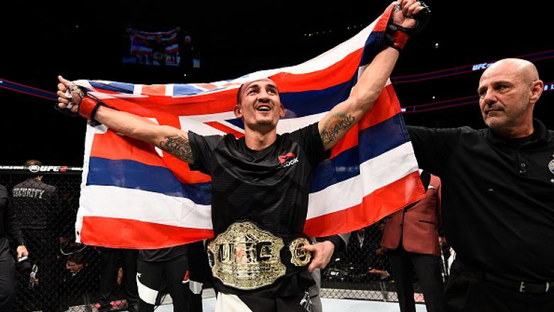 TORONTO, CANADA - DECEMBER 10:  Max Holloway celebrates his TKO victory over Anthony Pettis in their interim UFC featherweight championship bout during the UFC 206 event inside the Air Canada Centre on December 10, 2016 in Toronto, Ontario, Canada. (Photo