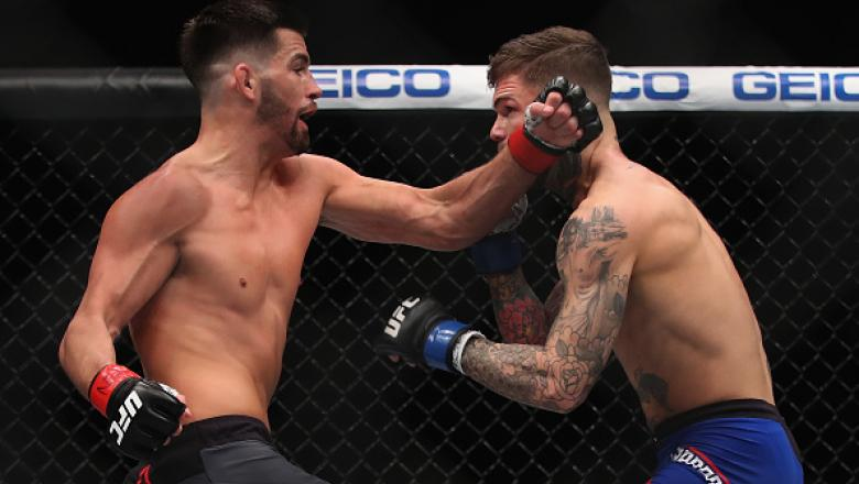 LAS VEGAS, NV - DECEMBER 30: (L-R) Dominick Cruz punches Cody Garbrandt in their UFC bantamweight championship bout during the UFC 207 event on December 30, 2016 in Las Vegas, Nevada.  (Photo by Christian Petersen/Getty Images)