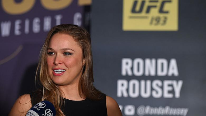 MELBOURNE, AUSTRALIA - NOVEMBER 13:  UFC women's bantamweight champion Ronda Rousey of the United States interacts with media during the UFC 193 Ultimate Media Day festivities at Etihad Stadium on November 13, 2015 in Melbourne, Australia. (Photo by Josh