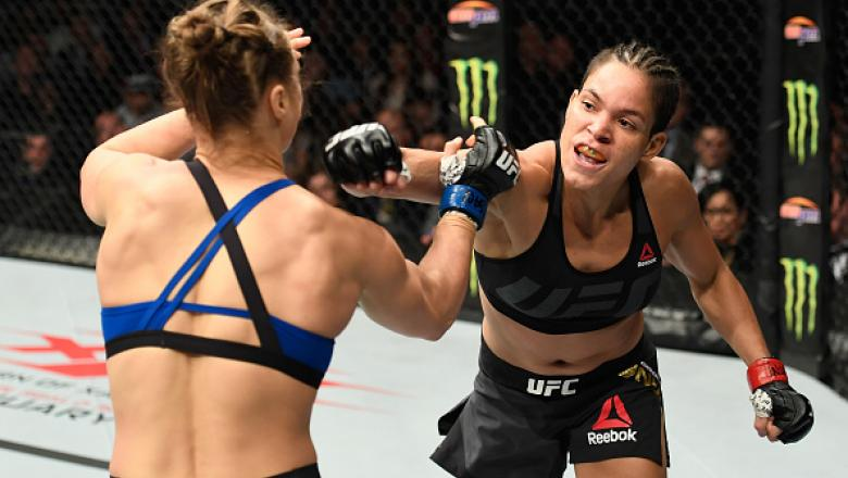 LAS VEGAS, NV - DECEMBER 30: (R-L) Amanda Nunes of Brazil punches Ronda Rousey in their UFC women's bantamweight championship bout during the UFC 207 event at T-Mobile Arena on December 30, 2016 in Las Vegas, Nevada.  (Photo by Josh Hedges/Zuffa LLC/Zuffa