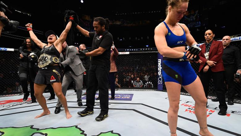 LAS VEGAS, NV - DECEMBER 30: Amanda Nunes of Brazil (left) reacts to her victory over Ronda Rousey (right) in their UFC women's bantamweight championship bout during the UFC 207 event at T-Mobile Arena on December 30, 2016 in Las Vegas, Nevada.  (Photo by