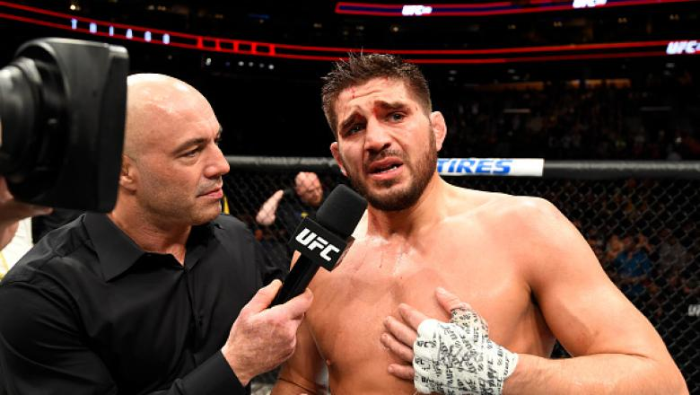 BUFFALO, NY - APRIL 08:  Patrick Cote of Canada throws down his gloves after his unanimous decision defeat to Thiago Alves of Brazil, signaling his retirement from UFC after their welterweight bout during the UFC 210 event at KeyBank Center on April 8, 20
