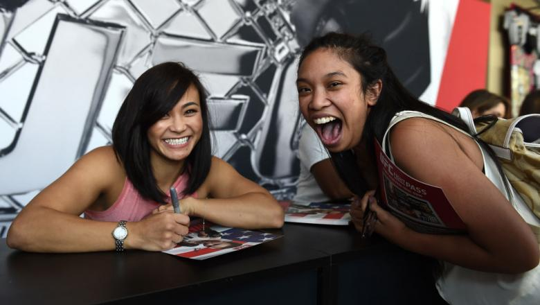 LAS VEGAS, NV - JULY 08:  Michelle Waterson meets with fans during an autograph session at T-Mobile Arena on July 8, 2017 in Las Vegas, Nevada. (Photo by Brandon Magnus/Zuffa LLC)