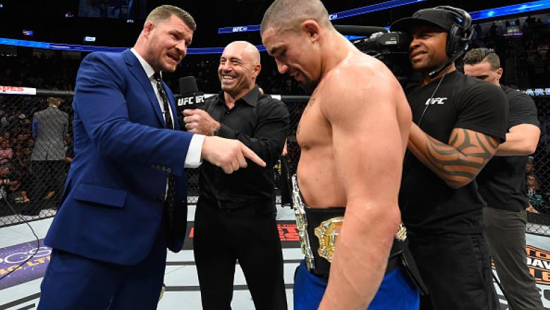 LAS VEGAS, NV - JULY 08:  (L-R) UFC middleweight champion Michael Bisping challenges newly crowned interim UFC middleweight champion Robert Whittaker of New Zealand after his victory over Yoel Romero during the UFC 213 event at T-Mobile Arena on July 8, 2