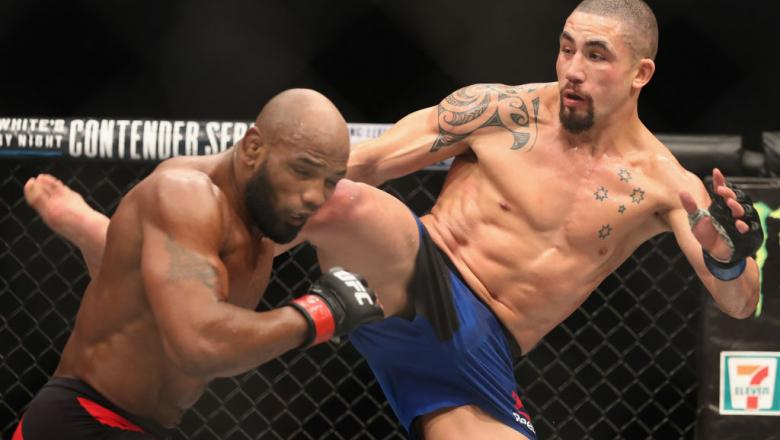 LAS VEGAS, NV - JULY 08:  (R-L) Robert Whittaker of New Zealand kicks Yoel Romero of Cuba in their interim UFC middleweight championship bout during the UFC 213 event at T-Mobile Arena on July 8, 2017 in Las Vegas, Nevada.  (Photo by Christian Petersen/Zu