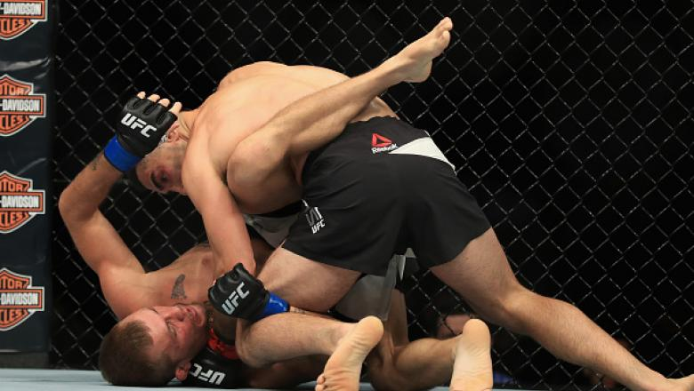 ANAHEIM, CA - JULY 29:  Ricardo Lamas (top) defeats Jason Knight during their Featherweight bout at UFC 214 at Honda Center on July 29, 2017 in Anaheim, California.  (Photo by Sean M. Haffey/Getty Images)
