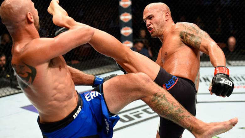 ANAHEIM, CA - JULY 29:  Robbie Lawler kicks Donald Cerrone in their welterweight bout during the UFC 214 event at Honda Center on July 29, 2017 in Anaheim, California.  (Photo by Josh Hedges/Zuffa LLC/Zuffa LLC via Getty Images)