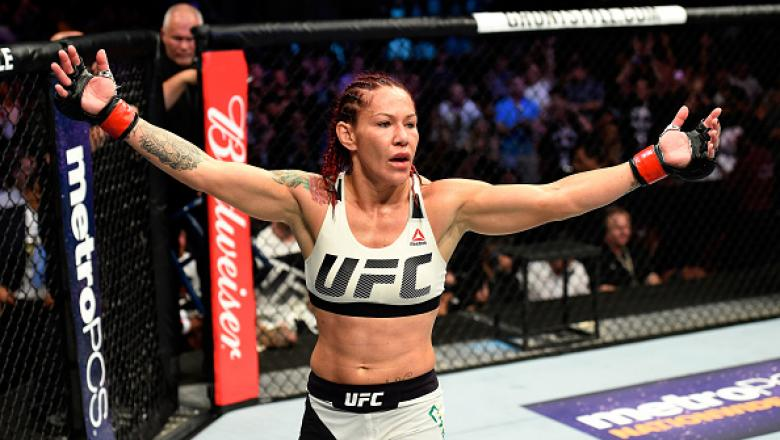 ANAHEIM, CA - JULY 29:  Cris Cyborg of Brazil reacts after defeating Tonya Evinger by TKO in their UFC women's featherweight championship bout during the UFC 214 event at Honda Center on July 29, 2017 in Anaheim, California.  (Photo by Josh Hedges/Zuffa L