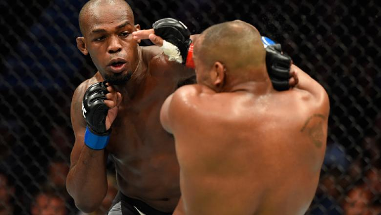ANAHEIM, CA - JULY 29:  Jon Jones punches Daniel Cormier in their UFC light heavyweight championship bout during the UFC 214 event at Honda Center on July 29, 2017 in Anaheim, California.  (Photo by Josh Hedges/Zuffa LLC/Zuffa LLC via Getty Images)