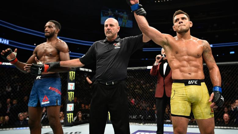 EDMONTON, AB - SEPTEMBER 09:  (R-L) Rafael Dos Anjos of Brazil celebrates his submission victory over Neil Magny in their welterweight bout during the UFC 215 event inside the Rogers Place on September 9, 2017 in Edmonton, Alberta, Canada. (Photo by Jeff