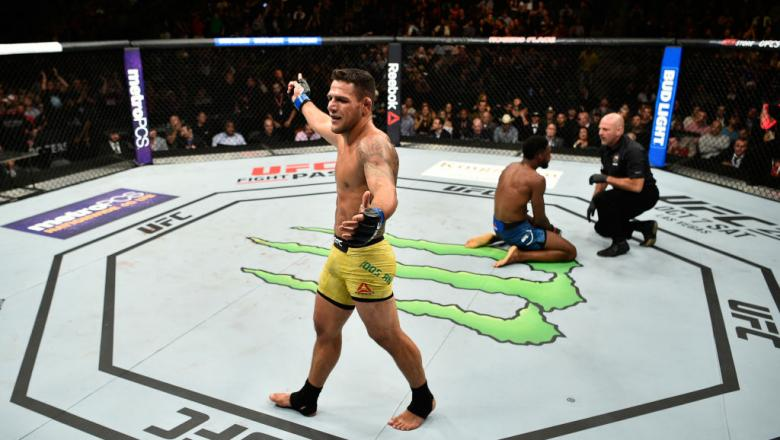 EDMONTON, AB - SEPTEMBER 09:  (L-R) Rafael Dos Anjos of Brazil celebrates his submission victory over Neil Magny in their welterweight bout during the UFC 215 event inside the Rogers Place on September 9, 2017 in Edmonton, Alberta, Canada. (Photo by Jeff