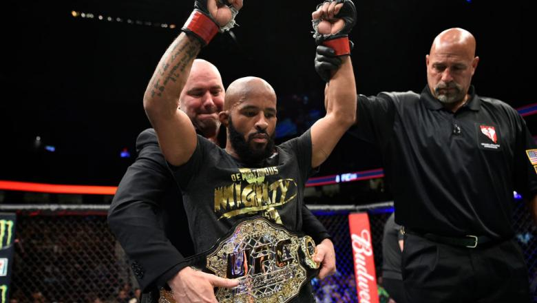 LAS VEGAS, NV - OCTOBER 07:   Demetrious Johnson celebrates after his submission victory over Ray Borg in their UFC flyweight championship bout during the UFC 216 event inside T-Mobile Arena on October 7, 2017 in Las Vegas, Nevada. (Photo by Jeff Bottari/