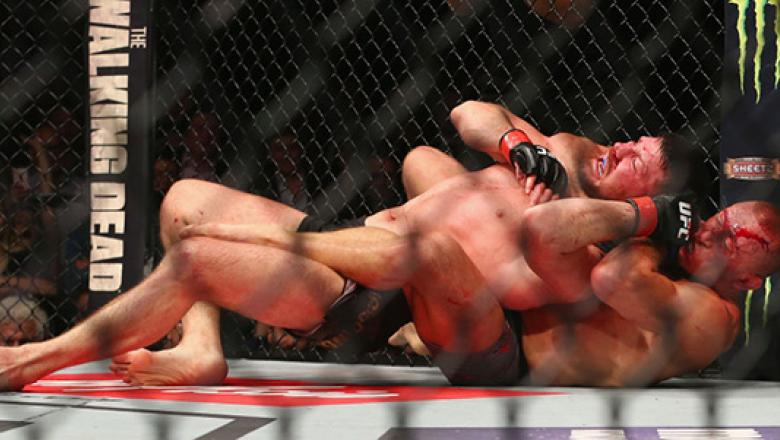 NEW YORK, NY - NOVEMBER 04:  Michael Bisping of England is pinned by Georges St-Pierre of Canada in their UFC middleweight championship bout during the UFC 217 event at Madison Square Garden on November 4, 2017 in New York City.  (Photo by Mike Stobe/Gett