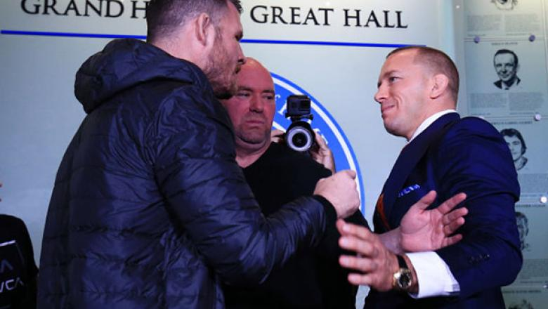 Michael Bisping and Georges St-Pierre face off following the UFC 217 press conference with Dana White at the Hockey Hall of Fame on October 13, 2017 in Toronto, Canada.  (Photo by Vaughn Ridley/Zuffa LLC)