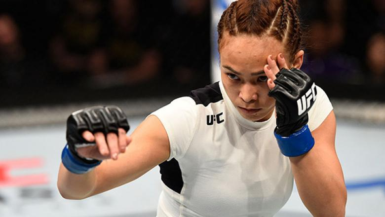 SACRAMENTO, CA - DECEMBER 17:  Michelle Waterson battles Paige VanZant (not pictured) in their women's strawweight bout during the UFC Fight Night event inside the Golden 1 Center Arena on December 17, 2016 in Sacramento, California. (Photo by Jeff Bottar