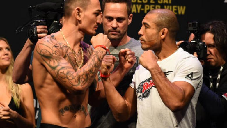 DETROIT, MI - DECEMBER 01:  (L-R) Max Holloway and Jose Aldo of Brazil face off during the UFC 218 weigh-in inside Little Caesars Arena on December 1, 2017 in Detroit, Michigan. (Photo by Josh Hedges/Zuffa LLC/Zuffa LLC via Getty Images)