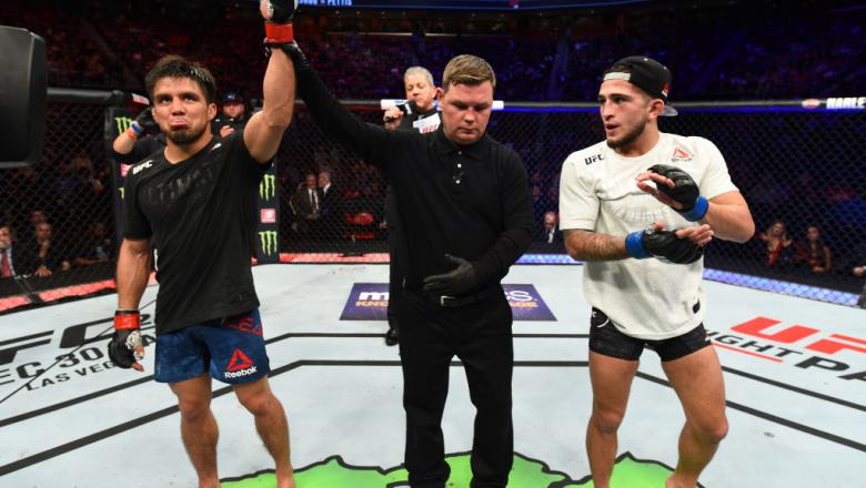 DETROIT, MI - DECEMBER 02:  (L-R) Henry Cejudo celebrates after defeating Sergio Pettis in their flyweight bout during the UFC 218 event inside Little Caesars Arena on December 02, 2017 in Detroit, Michigan. (Photo by Josh Hedges/Zuffa LLC/Zuffa LLC via G