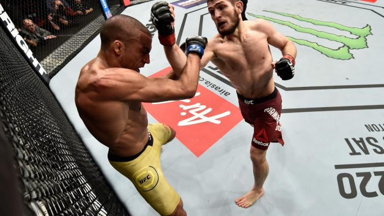 LAS VEGAS, NV - DECEMBER 30:  (R-L) Khabib Nurmagomedov of Russia punches Edson Barboza of Brazil in their lightweight bout during the UFC 219 event inside T-Mobile Arena on December 30, 2017 in Las Vegas, Nevada. (Photo by Jeff Bottari/Zuffa LLC/Zuffa LL