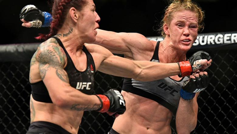 LAS VEGAS, NV - DECEMBER 30:  (L-R) Cris Cyborg of Brazil punches Holly Holm in their women's featherweight bout during the UFC 219 event inside T-Mobile Arena on December 30, 2017 in Las Vegas, Nevada. (Photo by Brandon Magnus/Zuffa LLC)