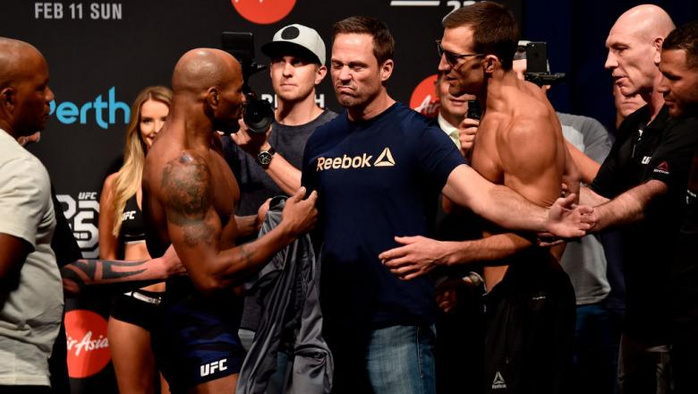 PERTH, AUSTRALIA - FEBRUARY 10:  (L-R) Opponents Yoel Romero of Cuba and Luke Rockhold face off during the UFC 221 weigh-in at Perth Arena on February 10, 2018 in Perth, Australia. (Photo by Jeff Bottari/Zuffa LLC/Zuffa LLC via Getty Images)