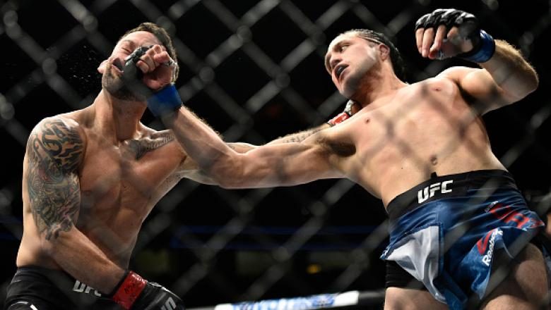 LAS VEGAS, NV - MARCH 03:   (R-L) Brian Ortega knocks out Frankie Edgar in their featherweight bout during the UFC 222 event inside T-Mobile Arena on March 3, 2018 in Las Vegas, Nevada. (Photo by Brandon Magnus/Zuffa LLC/Zuffa LLC via Getty Images)