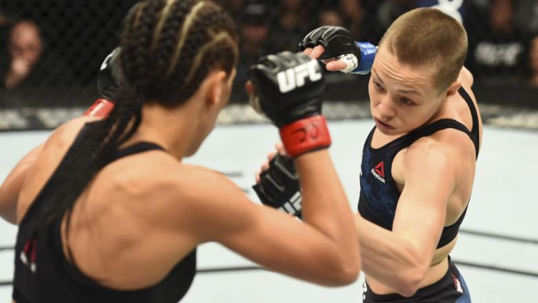 NEW YORK, NY - NOVEMBER 04:  (R-L) Rose Namajunas punches Joanna Jedrzejczyk of Poland in their UFC women's strawweight championship bout during the UFC 217 event inside Madison Square Garden on November 4, 2017 in New York City. (Photo by Josh Hedges/Zuf