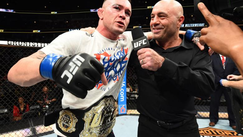 CHICAGO, ILLINOIS - JUNE 09:  Colby Covington is interviewed by Joe Rogan after defeating Rafael Dos Anjos of Brazil in their interim welterweight title fight during the UFC 225 event at the United Center on June 9, 2018 in Chicago, Illinois. (Photo by Jo
