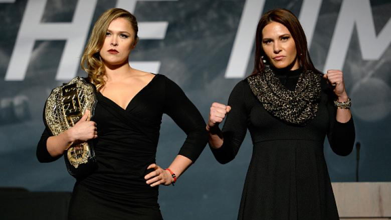 LAS VEGAS, NEVADA - NOVEMBER 17:  UFC women's bantamweight champion Ronda Rousey (L) and challenger Cat Zingano pose for the media during the UFC Time Is Now press conference at The Smith Center for the Performing Arts on November 17, 2014 in Las Vegas, N