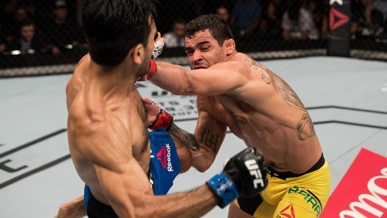 BRASILIA, BRAZIL - SEPTEMBER 24: Renan Barao of Brazil punches Phillipe Nover of the United States in their flyyweight UFC bout during the UFC Fight Night event at Nilson Nelson gymnasium on September 24, 2016 in Brasilia, Brazil. (Photo by Buda Mendes/Zu