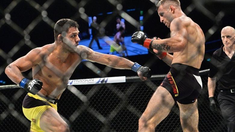 Rafael dos Anjos golpeia Tarec Saffiedine no UFC Singapura