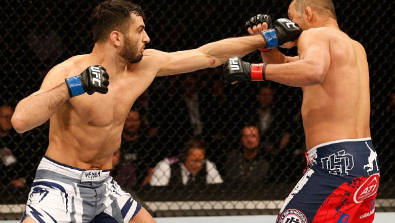 STOCKHOLM, SWEDEN - JANUARY 24:  (L-R) Gegard Mousasi of the Netherlands punches Dan Henderson of the United States in their middleweight bout during the UFC Fight Night event at the Tele2 Arena on January 24, 2015 in Stockholm, Sweden. (Photo by Josh Hed