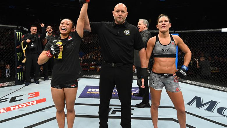 GLENDALE, AZ - APRIL 14:  (L-R) Michelle Waterson celebrates her victory over Cortney Casey in their womens strawweight fight during the UFC Fight Night event at the Gila Rivera Arena on April 14, 2018 in Glendale, Arizona. (Photo by Josh Hedges/Zuffa LLC