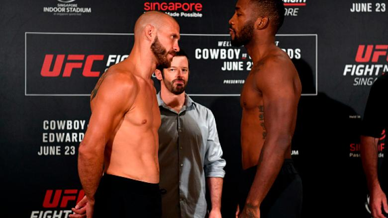 SINGAPORE - JUNE 22:  (L-R) Opponents Donald Cerrone of the United States and Leon Edwards of Jamaica face off during the UFC Fight Night weigh-in at the Mandarin Oriental on June 22, 2018 in Singapore. (Photo by Jeff Bottari/Zuffa LLC/Zuffa LLC via Getty